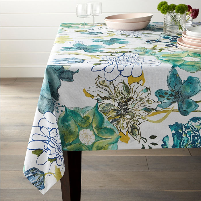 """Eden 60""""x90"""" Tablecloth Line-drawn and watercolor-rendered blooms blanket this glorious tablecloth with springtime florals in luminous shades of blue and green."""