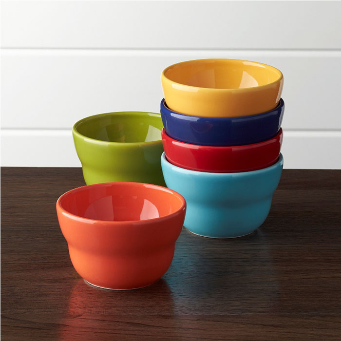 4in and 5.5in Bowls With gorgeous color, a high-gloss finish and a gently tapered, tiered design by ceramic artist Camilla Engdahl, this versatile earthenware bowl serves up snacks or ice cream with a generous helping of charm. Coordinating with matching bowls in red, aqua, blue, coral, green and yellow in two sizes.