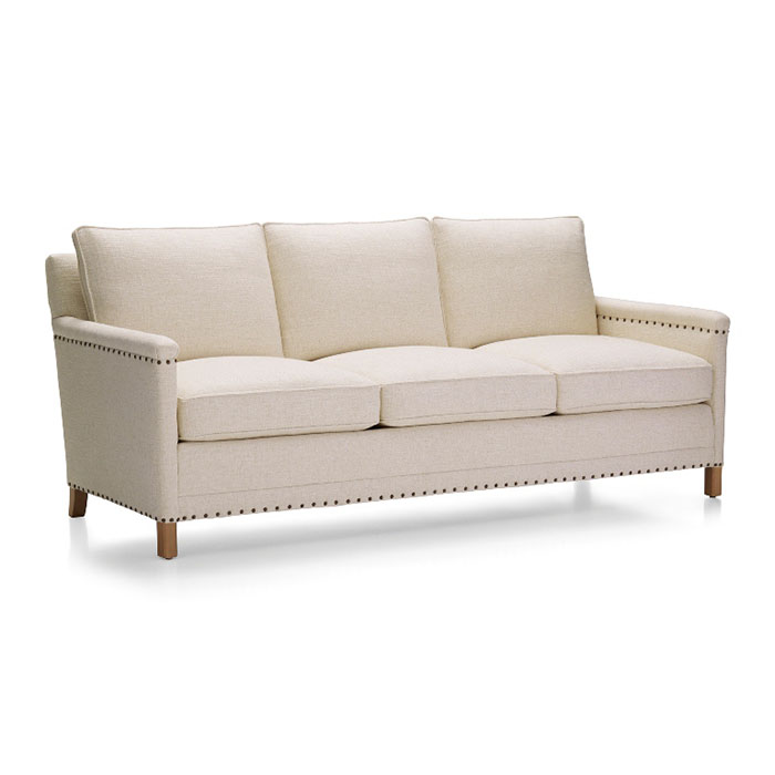 """Trevor 81"""" Sofa Our Trevor collection inherits the fine tradition of American craftsmanship with a clean modern style all its own. Impeccably tailored in an elegant spun-linen fabric, Trevor is tucked and tacked with antiqued nailheads, each precisely placed by hand. The sofa's comfort level is truly gold-standard, crafted with the support of eight-way, hand-tied springs, seat cushions lofted with down."""
