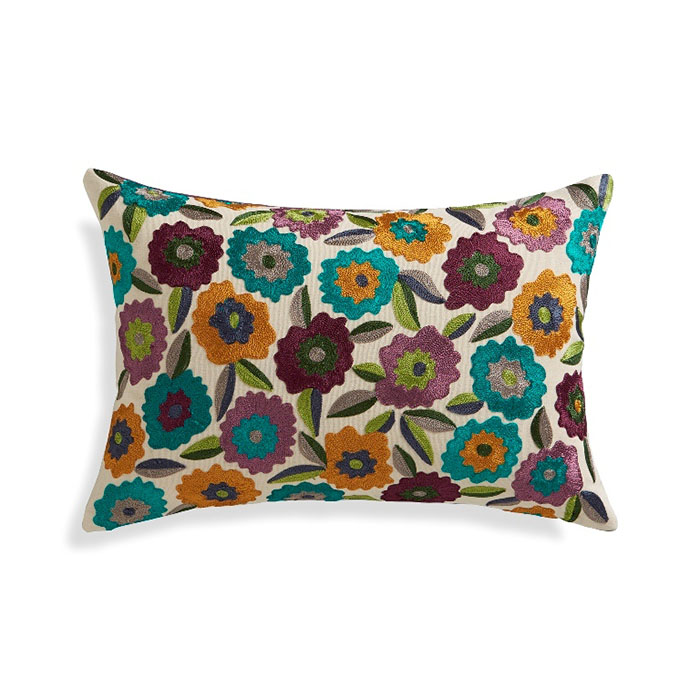 """Russo 18""""x12"""" Pillow Cover Hand-guided embroidery covers natural cotton with dozens of graphic flowers in a sophisticated and distinctive, multicolor palette. Pillow reverses to solid purple."""