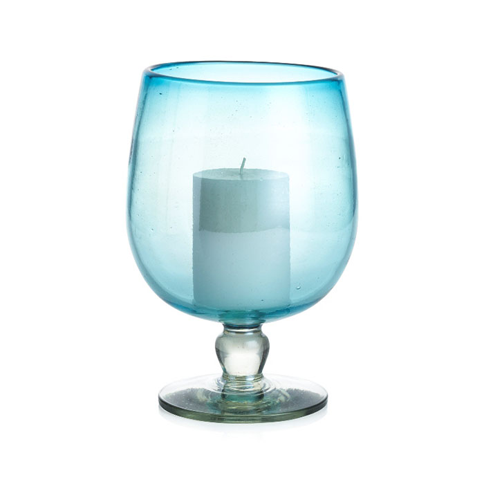 Del Mar Hurricane Candle Holder London-based designer Aaron Probyn envisioned this alluring hurricane in the tranquil blue of tropical seas. Handcrafted of eco-friendly French recycled glass, it is offset to maximum advantage by a clear, sculptural pedestal stem with a subtle luster finish.