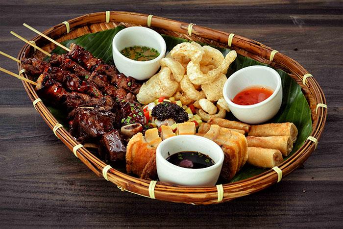 Filipino feast at C2 Classic Cuisine: Pamilyang Pinoy Bilao (Lechon Kawali, Beef Ribs BBQ, Pork BBQ, Shanghai, Chicken and Esaladang Mangga)