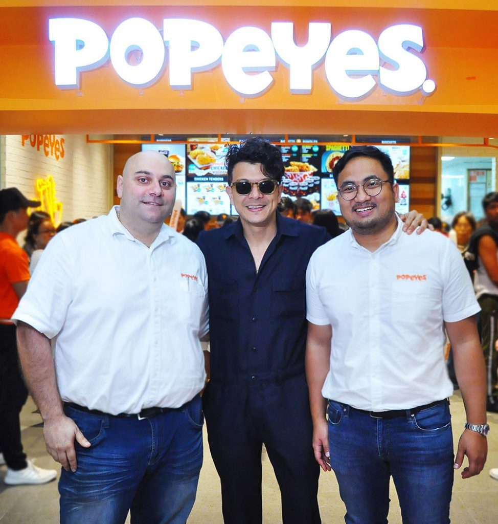 Popeyes Philippines chief operating officer Rami Chahwan, Jericho Rosales, and Kuya J Group CFO Francis Reyes