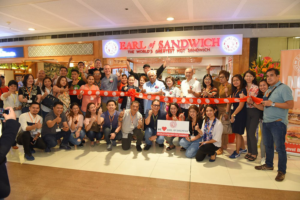Spearheading the Formal Grand Opening : Marcelino Florete Jr., - President and CEO, F&C Group of Companies (F&C) & master franchise of Earl of Sandwich Philippines, Susan Florete, Director and Matriarch (F&C) Marissa Florete – Gorriceta , EVP - Marketing and Merchandising, (F&C) Marcelino Florete III, EVP - Audit and Finance (F&C), Alex Garland, EARL OF SANDWICH managing Director for Europe, Middle East & India, Brian Stoudenmire, Culinary Operations Manager & Jenna Crawford, Operations Support Manager together with members of United Print Media Group, Inc. (UPMG, Inc.), a progressive organization of print media and publication companies in the Philippines with more than 30 active member-publications