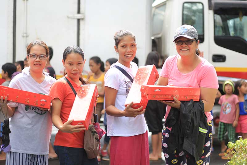 Beaming smiles of happiness as mothers proudly show-off their Triple Chocolate Rolls.