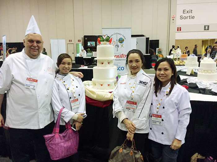 Chef Carol Lavin (3rd from left) with the President of CCFCC Chef Donald Gyokovitz, with CCA students