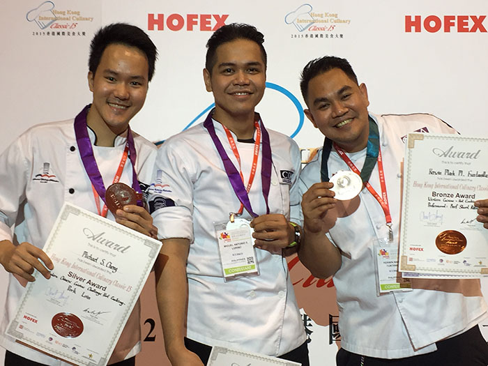 Chefs Michael Cheng, Miguel Antonio Lorino and  Kewin   Funtanilla with their medals.
