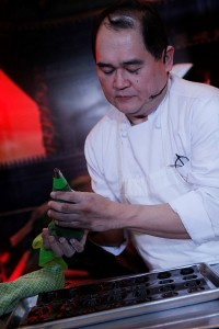 Chef Junjun de Guzman preparing his chocolate madeleines.
