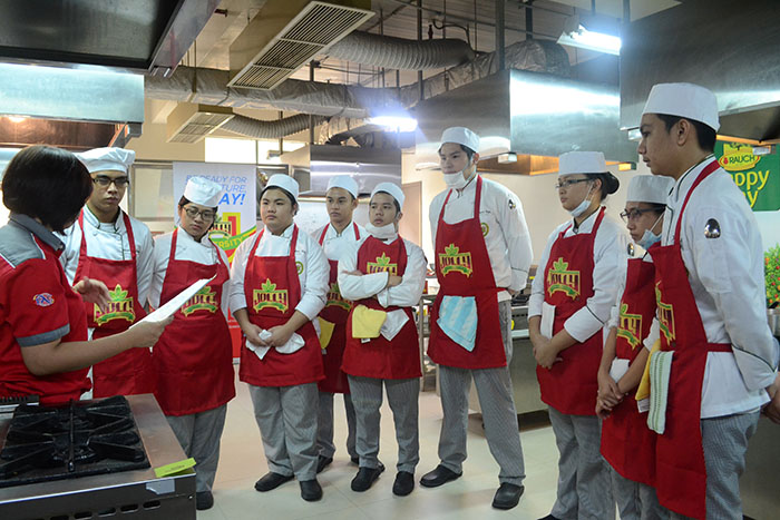 One of the Jolly University Mentors conducting the hands    on training in kitchen skills