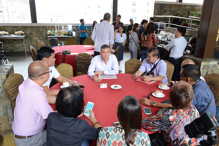 Mr. Leo de Leon (center) discusses the forthcoming event with the press corps.