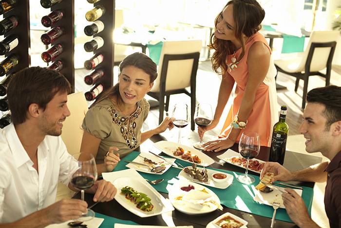 Guests Enjoying Tapas at Ibiza Beach Club Indoor