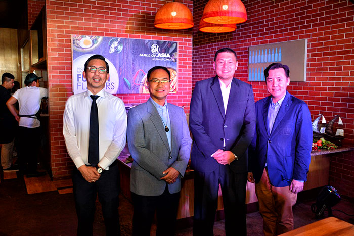 (L-R) DOT Marketing Development Group officer Dakila Rosales,  Tourism Promotions Board Marketing Communications Department's officer-in-charge Arnold Gonzales with SM SVP for Marketing Jon Jon Agustin, and SM Mall of Asia's AVP for Operations Perkin So during the press con of Madrid Fusion 2 at Sarsa Kitchen at SM Mall of Asia