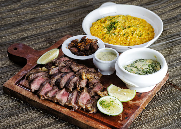 Bistecca Alla Toni & Sergio                                      Perfectly grilled porterhouse or rib eye with                                            golden risotto and creamed greens