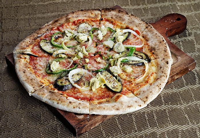 Pizza Vegetariana.                                        Brick oven pizza with tomato, mozzarella, onion,                                         eggplant, bellpepper, and artichokes
