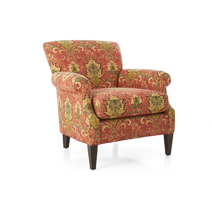 Elyse Chair, Santa Fe The perennially classic accent chair has graceful, curving keyhole arms, rich colors and elaborate details of an antique kilim rug. At once familiar and exotic, the upholstery showcases traditional design flourishes in a spice-inflected palette, printed with a multi-screen process to create its aged and weathered look.. The Elyse Chair is a Crate and Barrel exclusive.