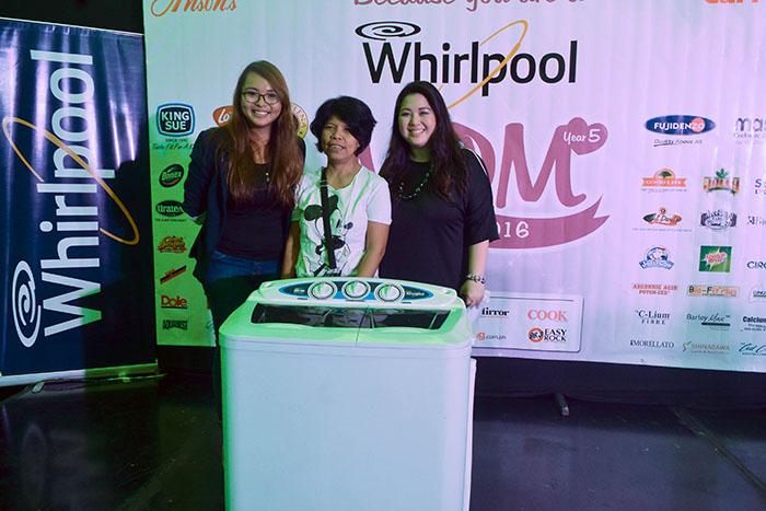 Event hosts Angel Tarriela and Joy Catiis-Cruz with raffle prize winner of Whirlpool washing machine