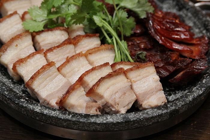 Crispy Pork Belly macau style (left) and Pork asado (right)