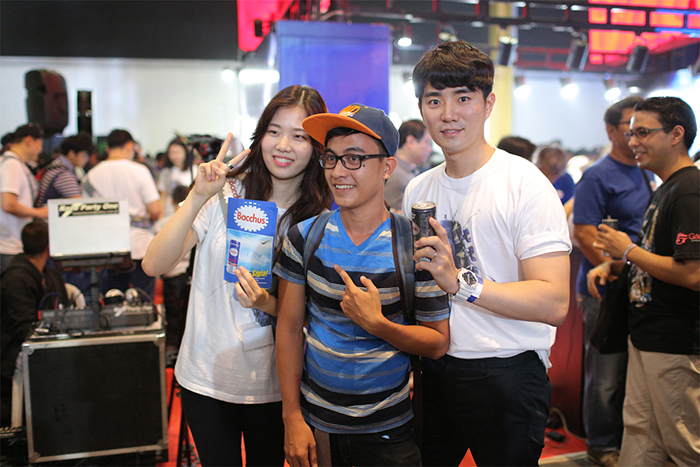 Avid egaming fans pose at the Bacchus booth