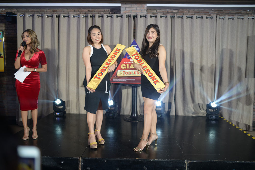 Models carrying the Giant Toblerones.