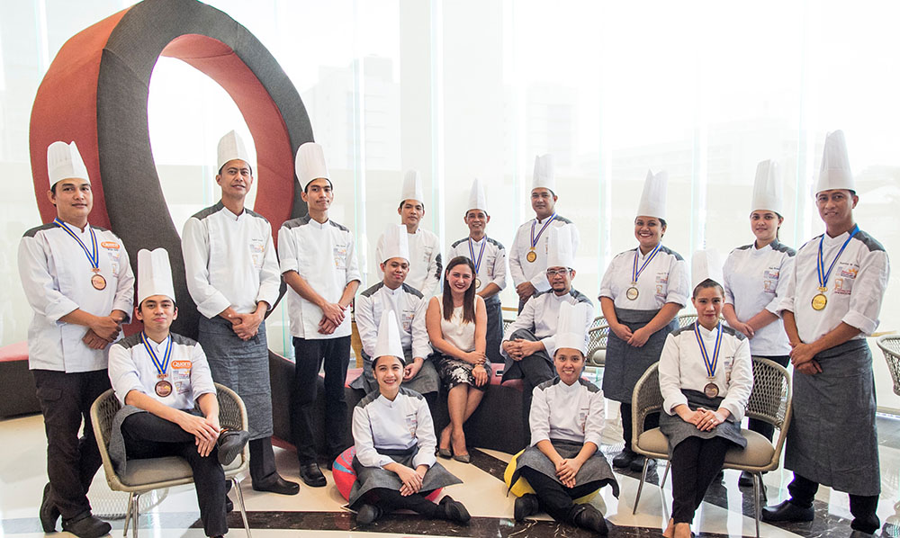 F1 Hotel Manila's Culinary Team together with the hotel's General Manager, Cindy Brual.