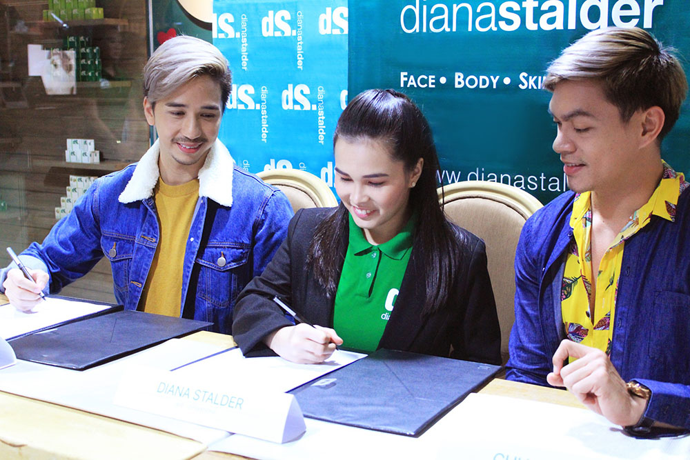 AVP for Operations Diana Stalder sitting between Joe Abad (left) and Chuck Aquino (right) at the contract signing for the social media influencers to be the latest faces of Diana Stalder Face, Body, Skincare, & Café.