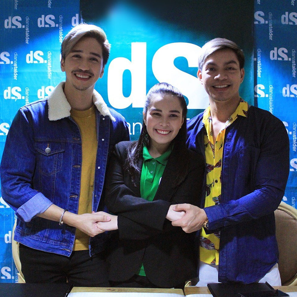 dS AVP for Operations Diana Stalder links hands with the brand's newest endorsers, Joe Abad and Chuck Aquino, symbolizing their partnership.