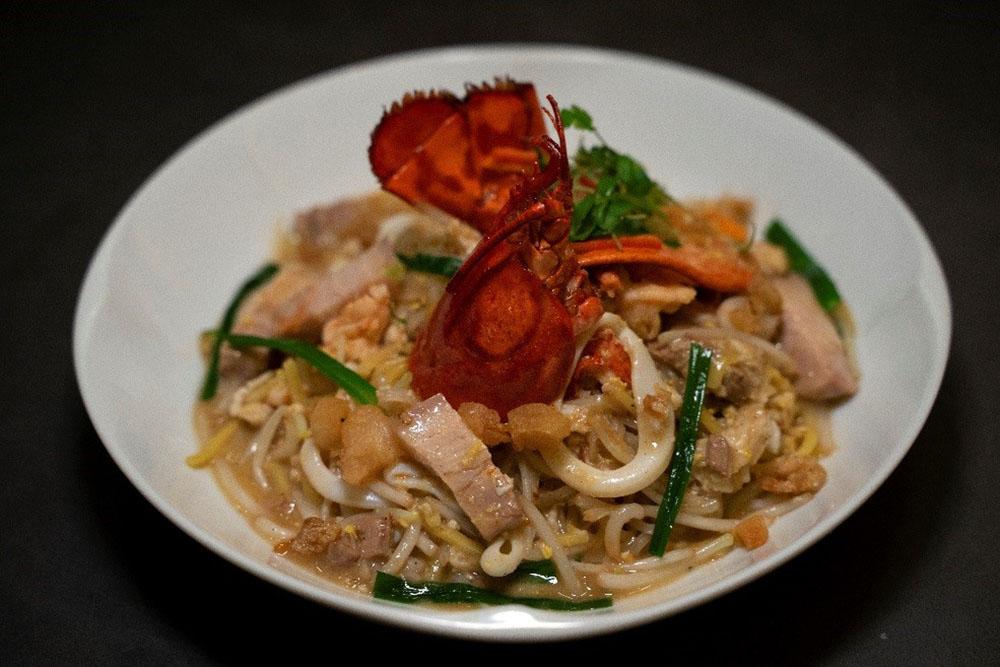 Chef Justin Quek's signature wok-fried Lobster Hokkien Mee