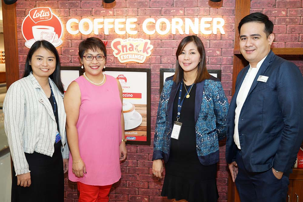 Lotus Coffee Corner by Snack Exchange is now at SM Makati. Shown in the area are Emie San Beda (Fly Ace Senior Product Manager), Kathleen Cruz (The SM Store Makati Branch Manager), Koinoniah Perez ( Snack Exchange Senior Merchandising Manager) and Joey Brillante ( The SM Store Makati Department Manager.)