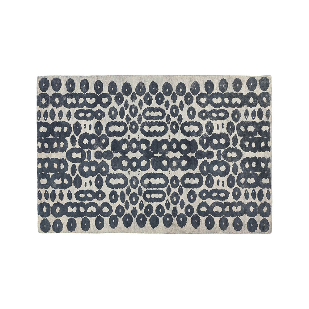 Orlo Blue Artisan Rug Freeform circles and rings update traditional carpet design in this contemporary rug designed by Laura Foster Nicholson. A simplified palette of dark blue on cream enhances the rug's graphic edge and modern attitude.