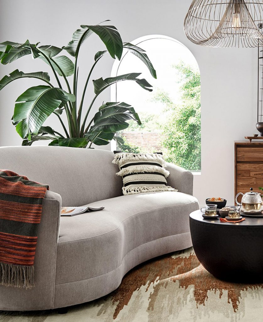 Channeling 1930s Hollywood, the Infiniti Sofa takes center stage in the modern living room with glamorous curves and velvety upholstery. The sofa's flowing lines sweep an asymmetrical tight back to complement its graceful kidney-shaped seat. The Infiniti Curve Back Sofa is a Crate and Barrel exclusive.