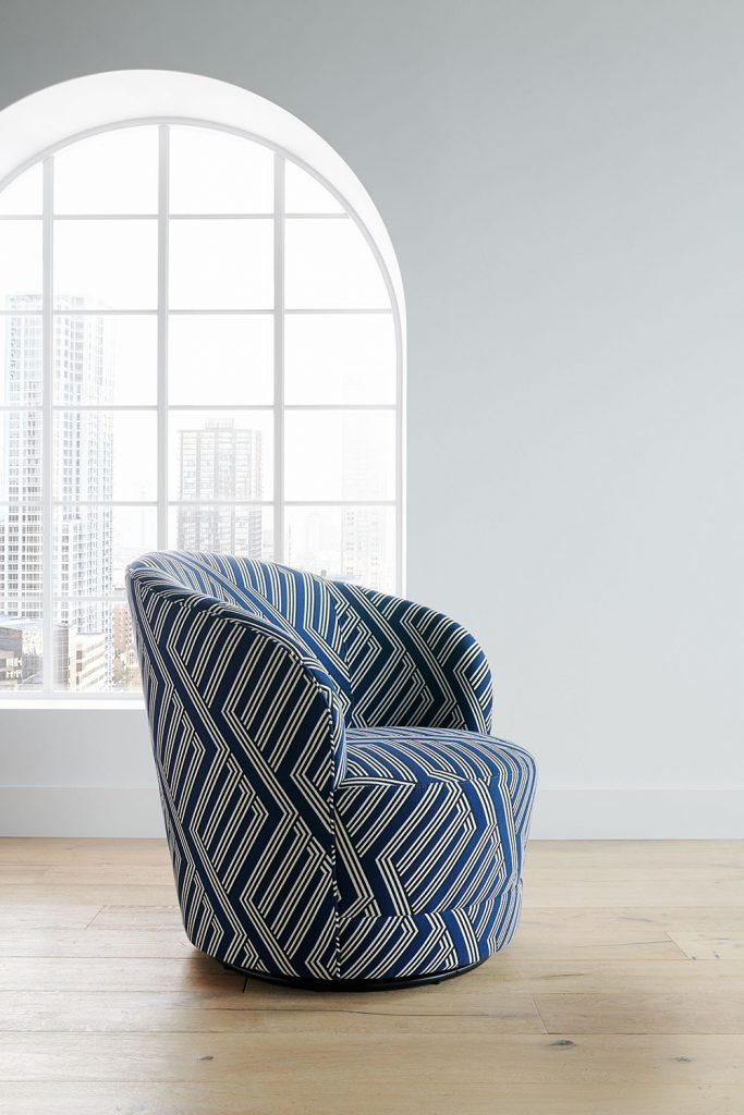 The Infiniti Swivel Chair shows off its glamorous curves in a refined fabric inspired by men's haberdashery patterns. Silky to the touch, this exclusive textile layers crisply colored ribbons to create a dramatic diamond pattern you'll find only at Crate and Barrel. Enjoy the cozy embrace of Infiniti's semi-circular tight back and snug cushion. The Infiniti Swivel Chair is a Crate and Barrel exclusive.