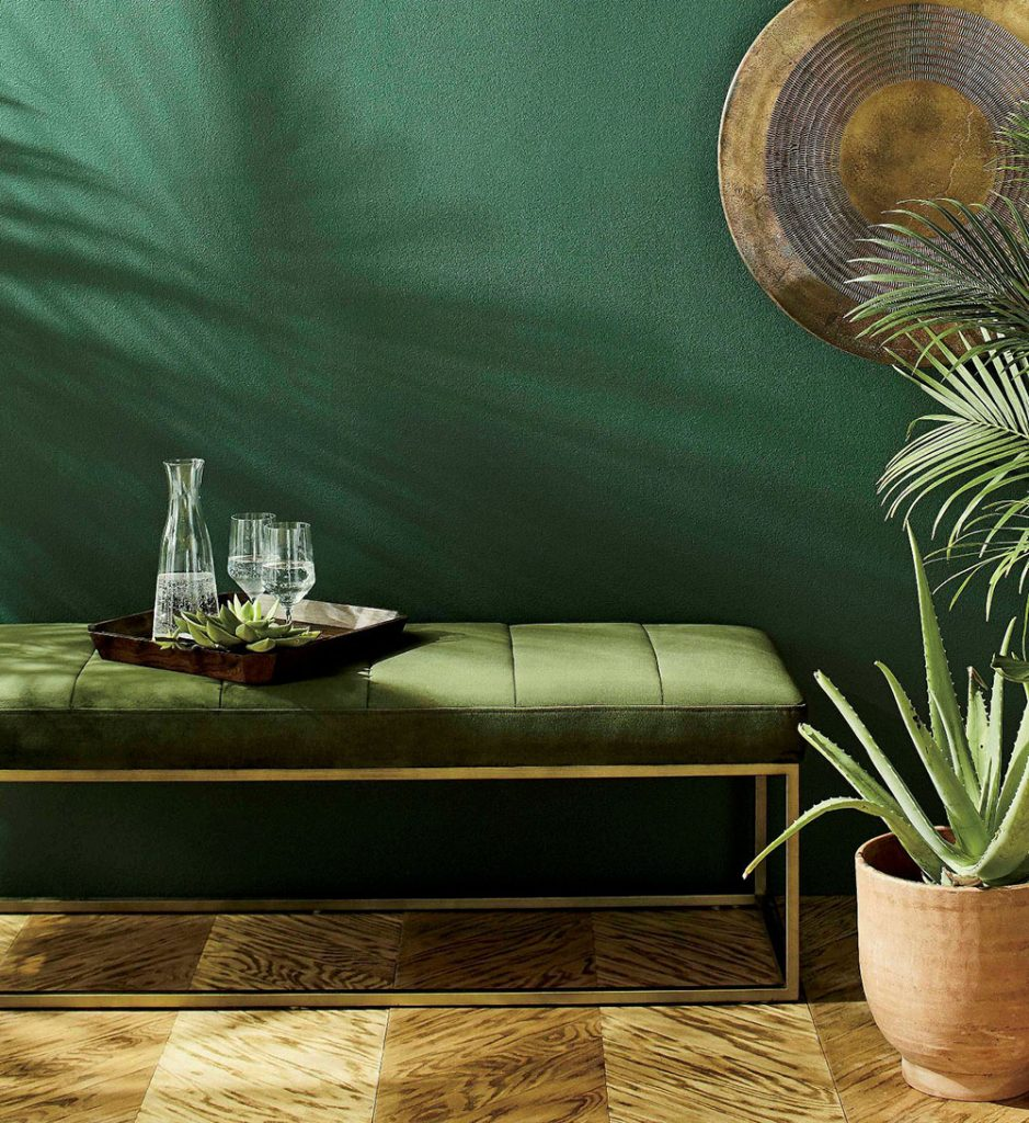 Channel Dark Green Velvet Bench Here's a luxurious little jewel for the foot of the bed or any place you need extra seating. Upholstered in deep green velvet the brass-framed bench is tailored with channel stitching. The Channel Dark Green Velvet Bench is a Crate and Barrel exclusive.