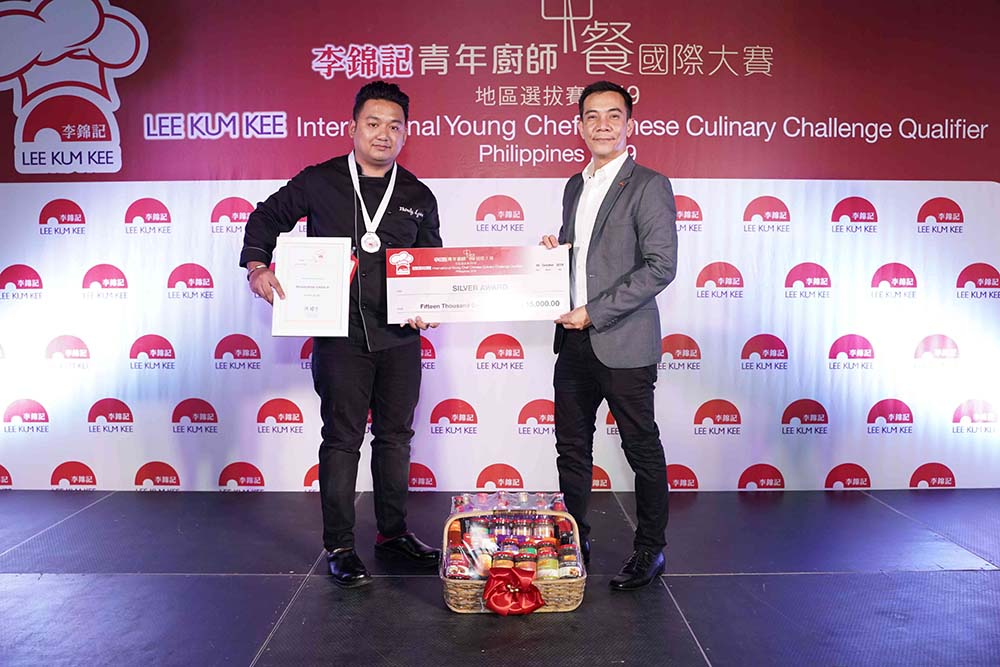 "Left to Right: Silver Awardee Muhajiran ""Pongky"" Ijiran III of Kuya J Restaurant and Mr. Ryan Cruz, Business Manager, Lee Kum Kee Philippines"