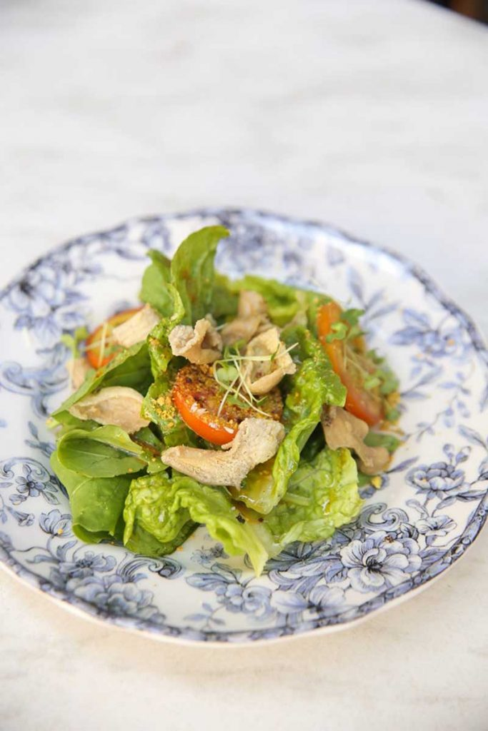 Tomato and Arugula Salad with Salted Egg Vinaigrette with Chicken Skin