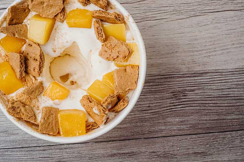 Mega Mangga! Vanilla custard blended with fresh mango and graham, topped with freeze-dried mango.