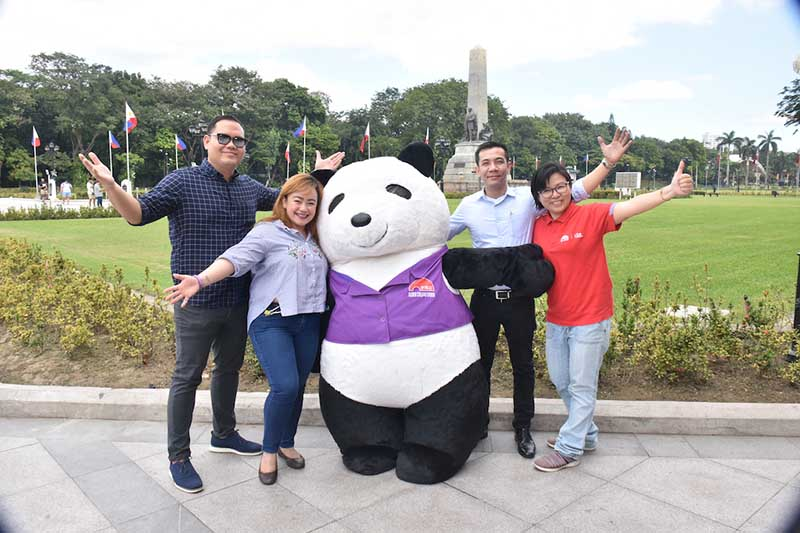 (L-R) Lee Kum Kee Philippines Asst Sales Manager for General Trade Mr. Linus Reyes, Lee Kum Kee Philippines Asst Sales Manager for Food Service Ms. Patricia Mejorada, Lee Kum Kee's Panda Mascot, Lee Kum Kee Philippines Business Manager Mr. Ryan Cruz, Lee Kum Kee Philippines Product Manager Ms. Ann Foo