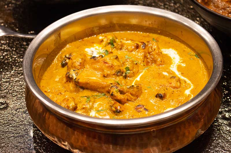 Murgh Musallam (charcoal-roasted chicken cooked in rich onion and cashew gravy)