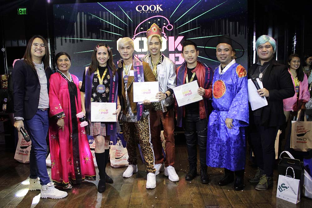 From left: Event host Perry Gamboa, Hall of Fame Lariza Garcia, cooKPOP 1st Runner Up Llena Tan, Best in cooKPOP Attire Joe Abad with tandem Chuck Aquino, 2nd Runner Up Sylver Sy, Advertising Sales Manager Marlon Aldenese, and event host Choi Soriano