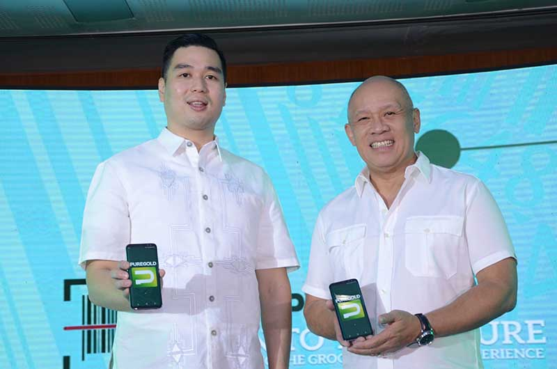 Puregold President Vincent Co with Globe President and CEO Ernest Cu copy