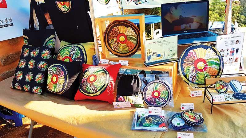 Different souvenir items with bibimbap design copy