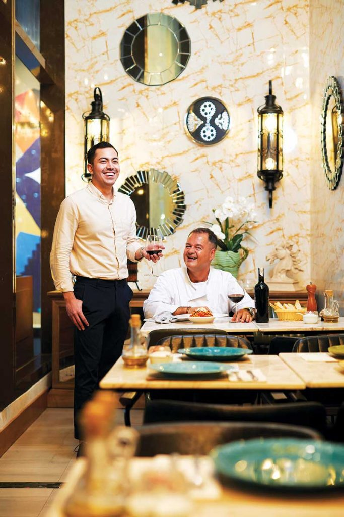 (L) Giulius S. Iapino, Chief Executive and President of Rigatoni Corporation Eatalian Inc. with (R) Mamma Mia's new chef Alessandro Carossi