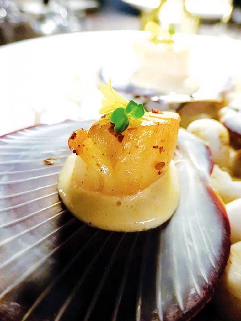 Scallop with Sea Urchin Mousse, Green Pea Emulsion, and Micro Arugula