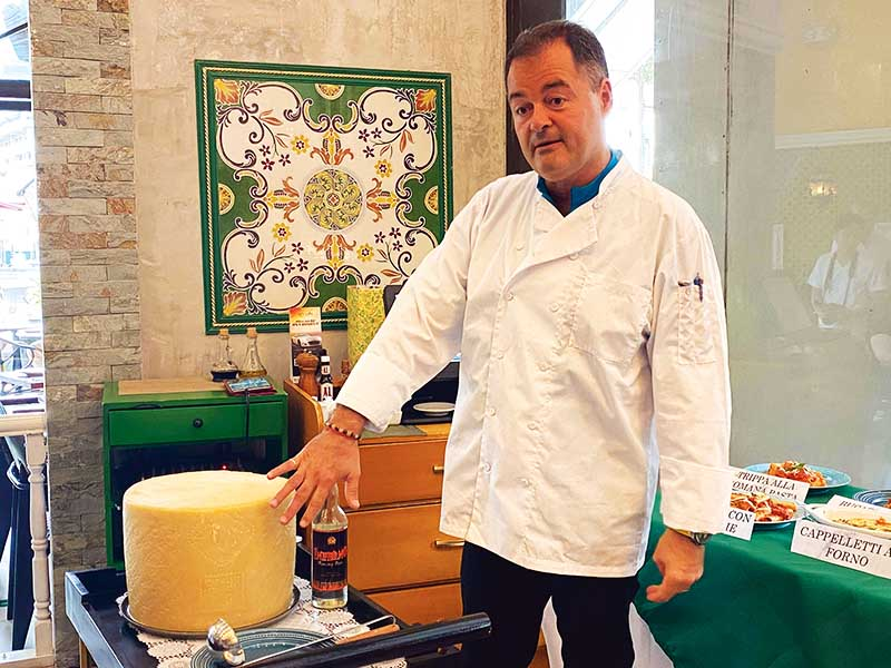 Chef Alessandro Carossi showcasing the Pecorino Romano Cheese Wheel bowl