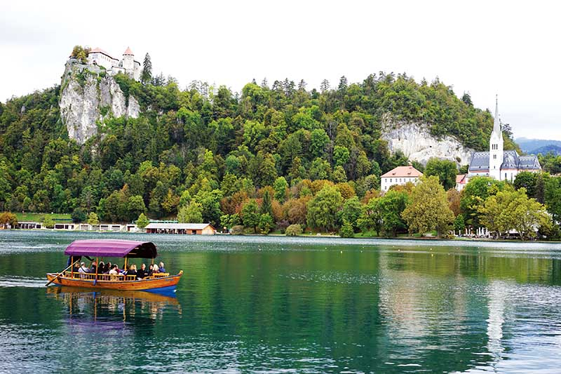Lake Bled with Bled Castle (L) and St Martina Parish Church (R)